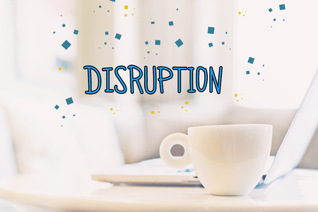 disruptive: Disruption concept with a cup of coffee and a laptop