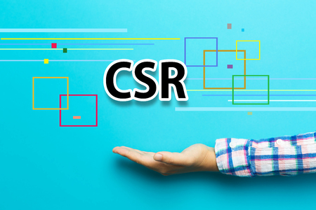CSR concept with hand on blue background