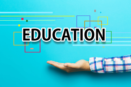 knowledge business: Education concept with hand on blue background Stock Photo