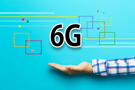 6G concept with hand on blue background