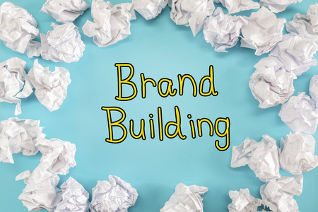 Brand Building text with crumpled paper balls on a blue background