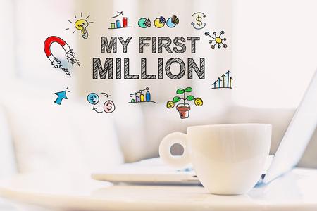 Mijn eerste miljoen concept met een kopje koffie en een laptop