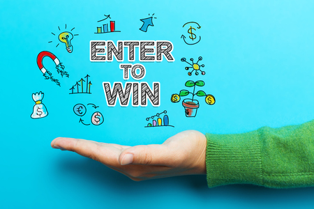 Enter to Win with hand on blue background