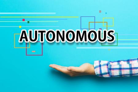 Autonomous concept with hand on blue background Stock Photo