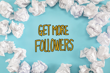 Get More Followers text with crumpled paper balls on a blue background