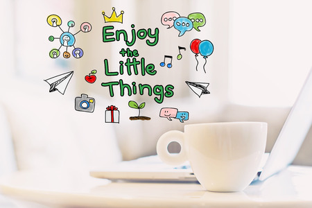 Enjoy The Little Things concept with a cup of coffee and a laptop