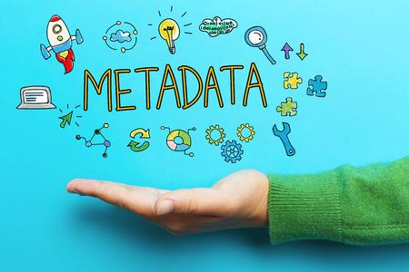 파란색 배경에 손으로 메타 데이터 개념 스톡 콘텐츠