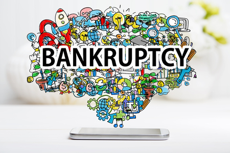 Bankruptcy concept with smartphone on white table Stok Fotoğraf