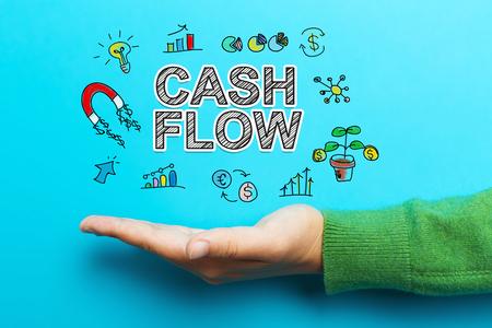 Cash flow met hand op blauwe achtergrond