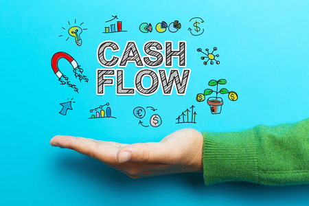 Cash Flow with hand on blue background