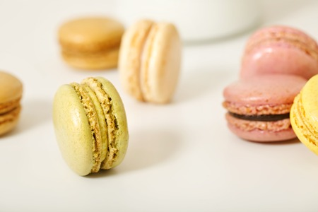 Macarons on a white table top background