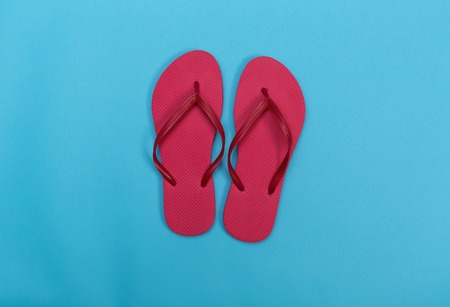 Beach sandals on a vibrant blue background Stock Photo - 79918420