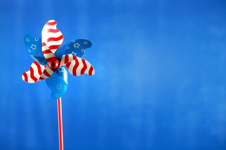 American holiday pinwheel on blue background Stock Photo