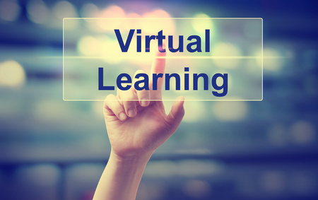 Virtual Learning concept with hand pressing a button Stock Photo