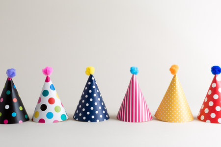 Party theme with with hats on an off white background Stock Photo