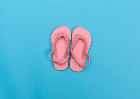 Beach sandals on a vibrant blue background Stock Photo - 79963455