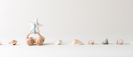 Toy car summer travel theme with seashells and starfish Фото со стока