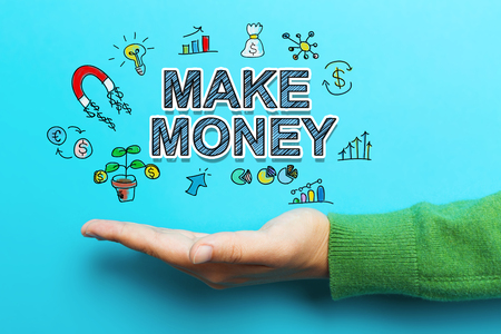 Make Money concept with hand on blue background