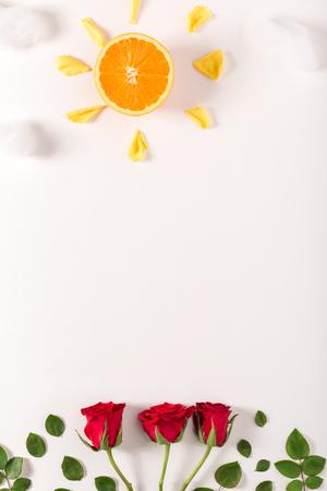 Orange sun shinning down on roses
