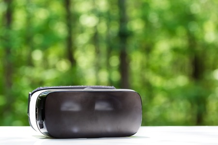 futurist: Virtual reality headset device with forest background