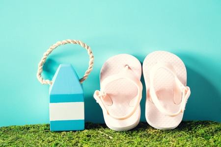 Summer theme with sandals and starfish on a bright blue background Stock Photo - 80382410