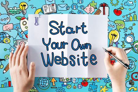 Start Your Own Website text with hands and colorful illustrations Stock Photo