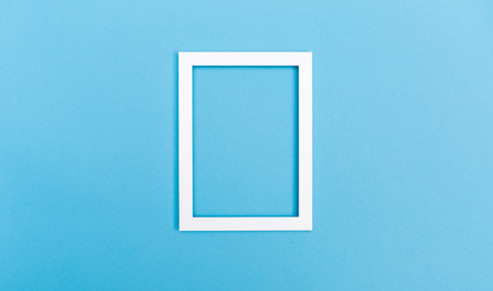 Empty picture frame on a bright solid background