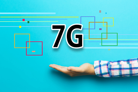 7G concept with hand on blue background Stock Photo