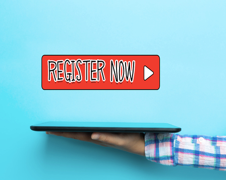 Register Now concept with a tablet on blue background Stock Photo