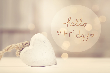Hello Friday message with a white heart  in a room