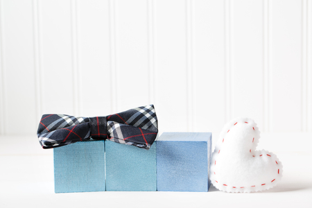 Blue wooden blocks with heart cushion on a white table Stok Fotoğraf