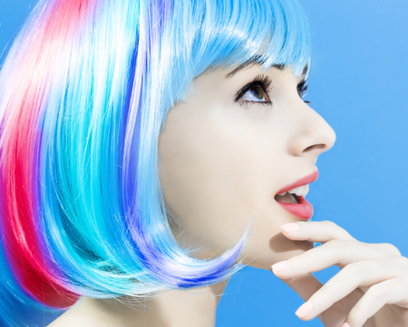 Beautiful woman in makeup with a bright blue wig Stock Photo