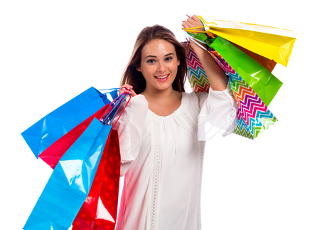 shopper: Happy young woman holding shopping bags on a white background Stock Photo