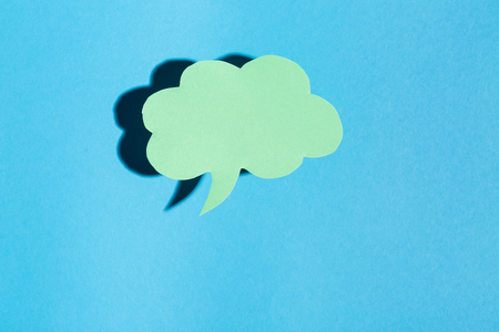 Speech bubble text message theme with hard shadow on a blue background Stok Fotoğraf