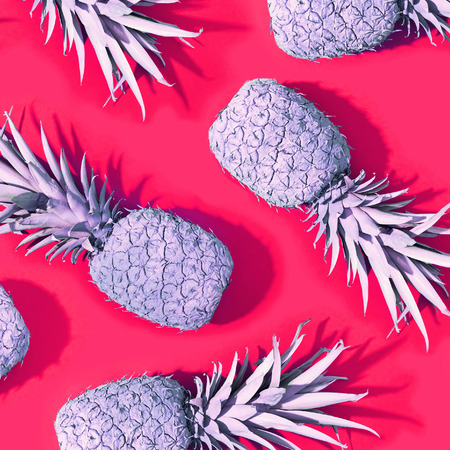 Pink painted pineapples on a magenta background Stock Photo
