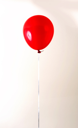 Floating balloon on an off white background 版權商用圖片