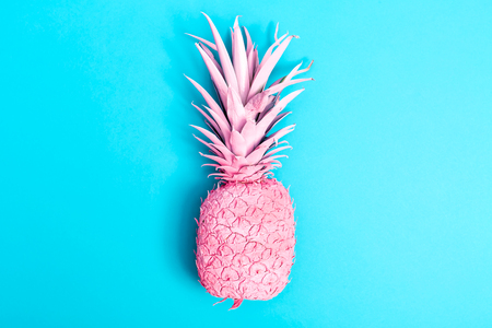 Painted pink pineapple on a blue background