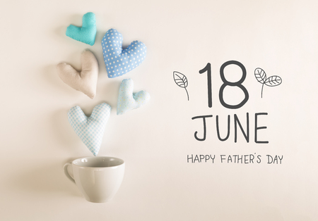 Fathers Day message with blue heart cushions coming out of a coffee cup Banco de Imagens