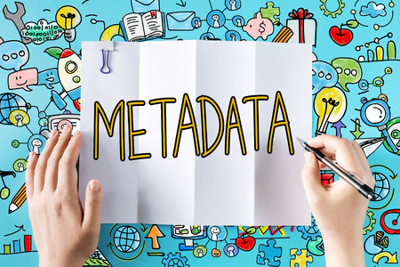 Metadata text with hands and colorful illustrations Stock Photo