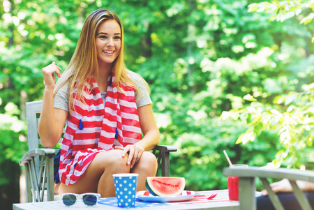 American girl hanging out on the fourth of July in her backyard Stock Photo