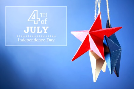 four objects: 4th of July American Independence Day decorations on blue background Stock Photo