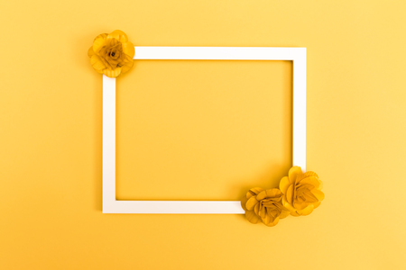 Picture frame with flowers on a yellow background Stok Fotoğraf - 80956245