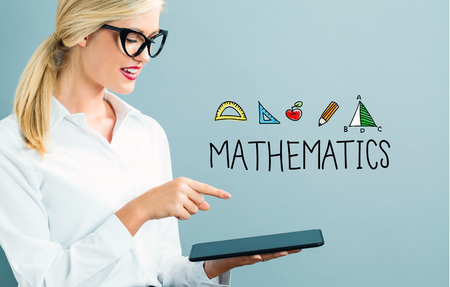 Mathematics text with business woman using a tablet Stock Photo