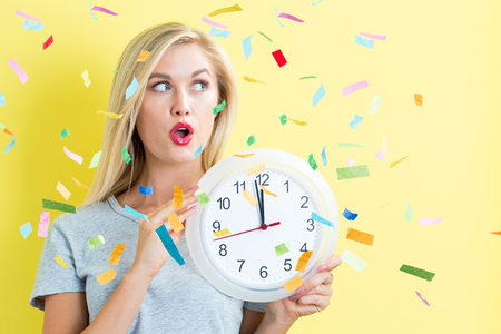oclock: Happy woman celebrating with confetti party theme