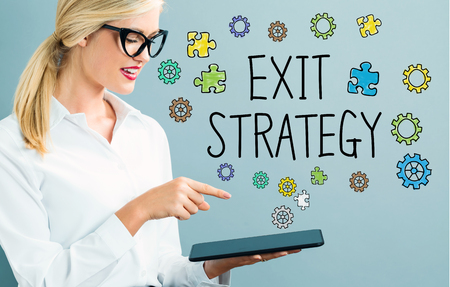 Exit Strategy text with business woman using a tablet