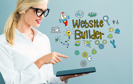 Website Builder text with business woman using a tablet Banque d'images