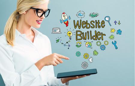 Website Builder text with business woman using a tablet Reklamní fotografie