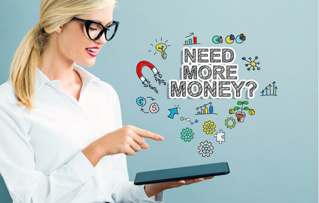 Need More Money text with business woman using a tablet Reklamní fotografie