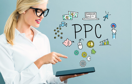 PPC text with business woman using a tablet