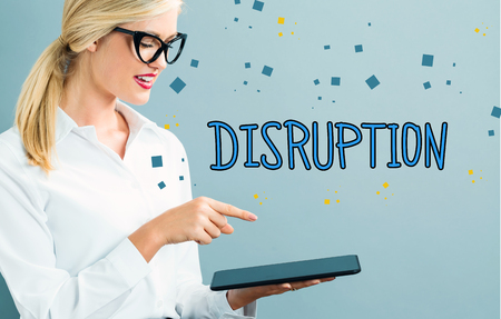 Disruption text with business woman using a tablet